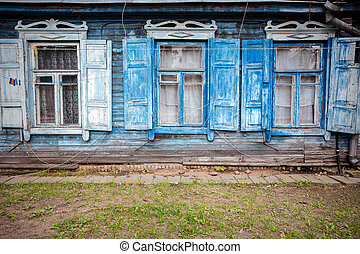 Old blue wall with some windows