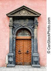 Old brown wooden door.