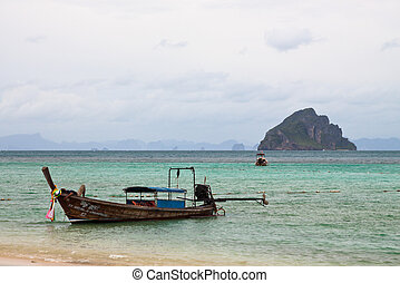 Phi Phi island - Beautiful coast in and long tail boats Phi...