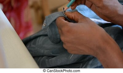 African tailor - hands of a seamstress African