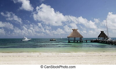 beach with wooden pier and bungalow - vacation, travel,...