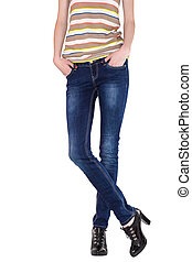Shapely female legs dressed in dark blue jeans, striped...