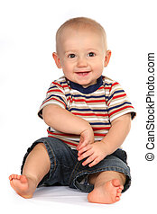 Cute Baby Boy Toddler Sitting and Holding Hand on White...