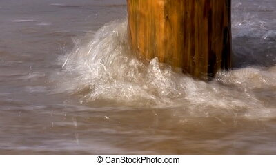 Close up of pole in the sea water - Close up view of sea...