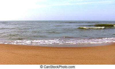 Calm sea, sandy beach