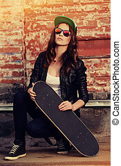 hobby life - Modern girl teenager stands with skateboard...