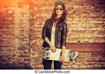 girl with skateboard - Modern girl teenager stands with...