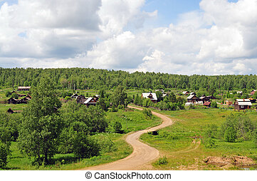 countryside landscape - homes, road, forest