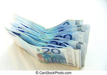 20 euro banknotes - stacked 20 euro banknotes on white...