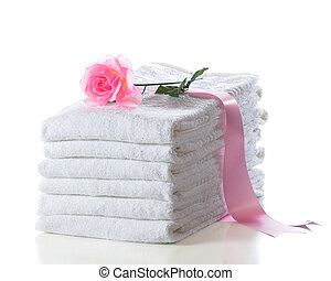 Towels - A stack of fluffy white towels wrapped in a broad...