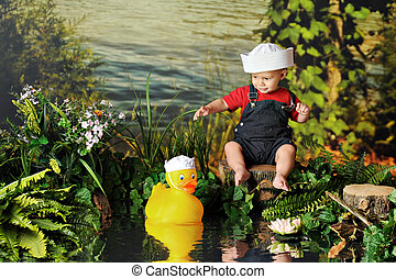 Two Tiny Sailors - A barefoot baby boy in a sailor\'s hat...