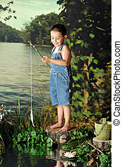 First Fish - A young, barefoot boy delighted when catching...