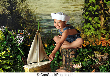 Young Sailor - A kindergarten boy in a sailor\'s hat sailing...