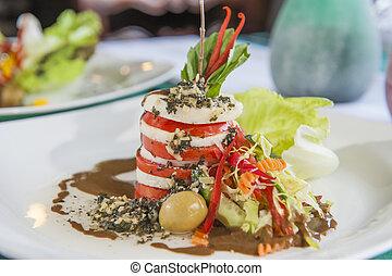 Closeup of tomato and mozzarella appetizer