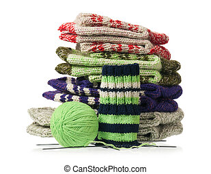 Knitted socks - Pile of knitted socks with spokes and...