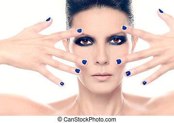 Fashion model with blue nail polish up close on white...
