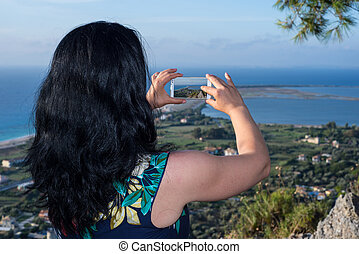 Woman taking photo of Lefkada city