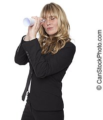 Businesswoman looking through a paper tube