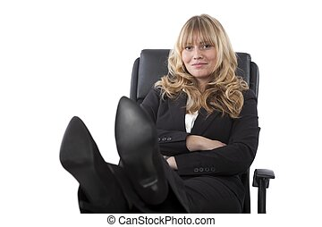 Female executive sitting with her feet up - Confident female...