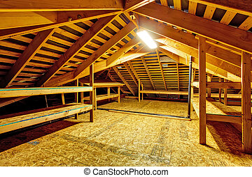 Empty attic with storage shelves - Attic interior in empty...