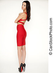 Young slim sexy woman in red dress isolaten on white...