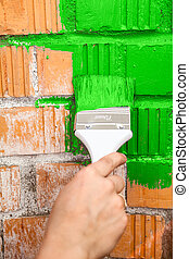 Orange brick wall painted with green color - Orange brick...