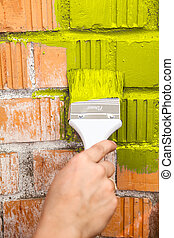 Orange brick wall painted with yellow color - Orange brick...