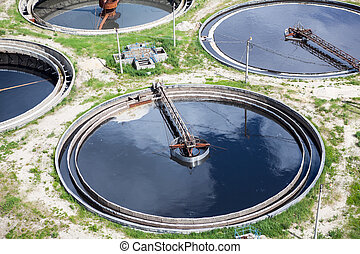 Four round full water settlers for sewage recycling - Four...