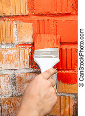 Orange brick wall painted with red color - Orange brick wall...
