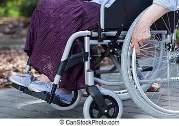 Close-up of legs of a disabled woman