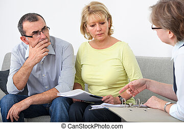 Advisory service for debtors - Mature couple getting...