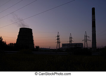 Power station over orange and blue sky