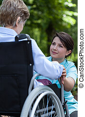 Nurse supports the older a woman with a disability