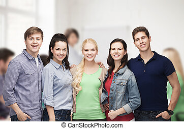 group of standing smiling students - education and people...