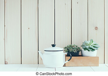 Vintage home arrangement, summer plants and enamelware on a...