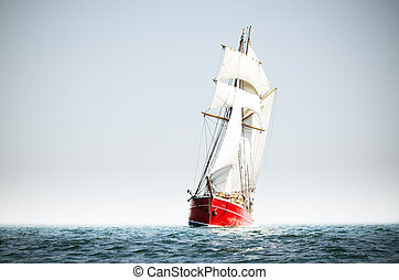 Red schooner sailing on the baltic sea