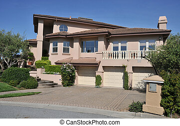 House with three car garage, two stories