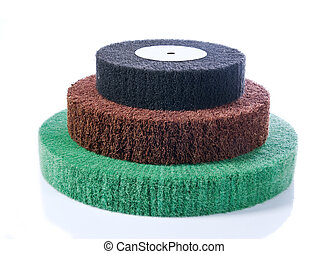Three abrasive wheels in the colours green, red and black...
