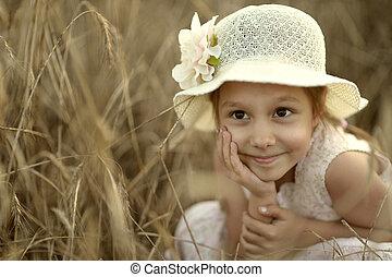 Dreaming girl in fied - Cute little girl dreaming in wheat...