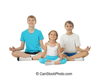 Two boys and girl meditating isolated on white background