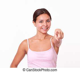 Friendly hispanic girl pointing at you