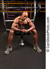 Bench Press Weight Training - Weight lifter sitting at the...