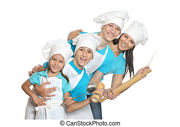 Cheerful chef with assistants - Cheerful female chef with...
