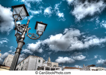 hdr lamp post - lamp post under a dramatic sky in hdr tone