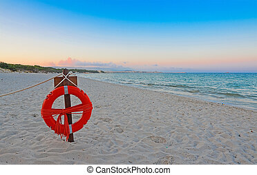 life buoy at the beach - life buoy at dawn in Alghero