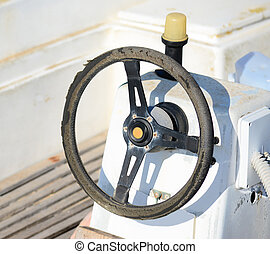 old steering wheel in a white boat