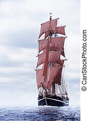 Black schooner - Schooner with beautiful red sails on the...
