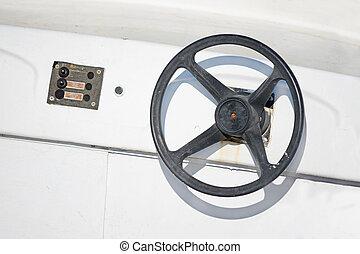 steering wheel - black steering wheel in an old boat