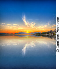 sunset reflection - colorful sunset in Alghero, Sardinia