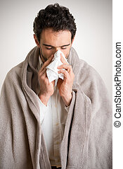 Sick Man Sneezing - Pale sick man with a flu, sneezing, in a...